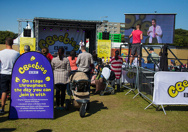 CBeebies stage branding alongside a vibrant Pop-Up banner