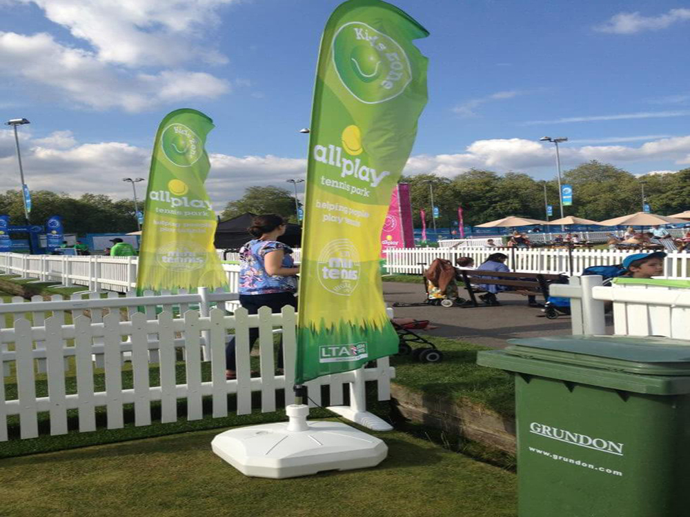 Promotional Feather Flags for the All Play tennis park created by the Lawn Tennis Association