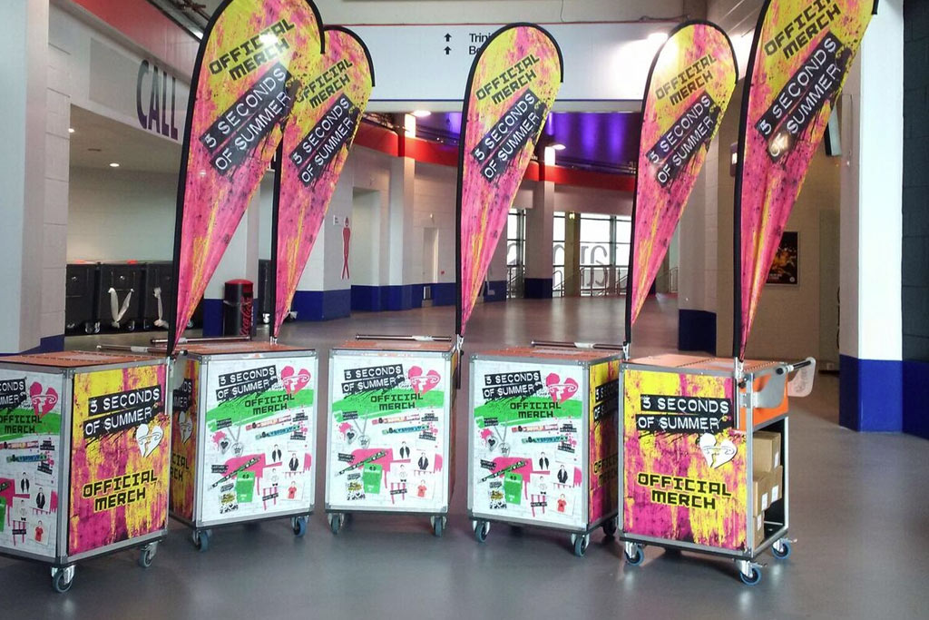 5 Seconds of Summer concert branding with teardrop flags and chariots