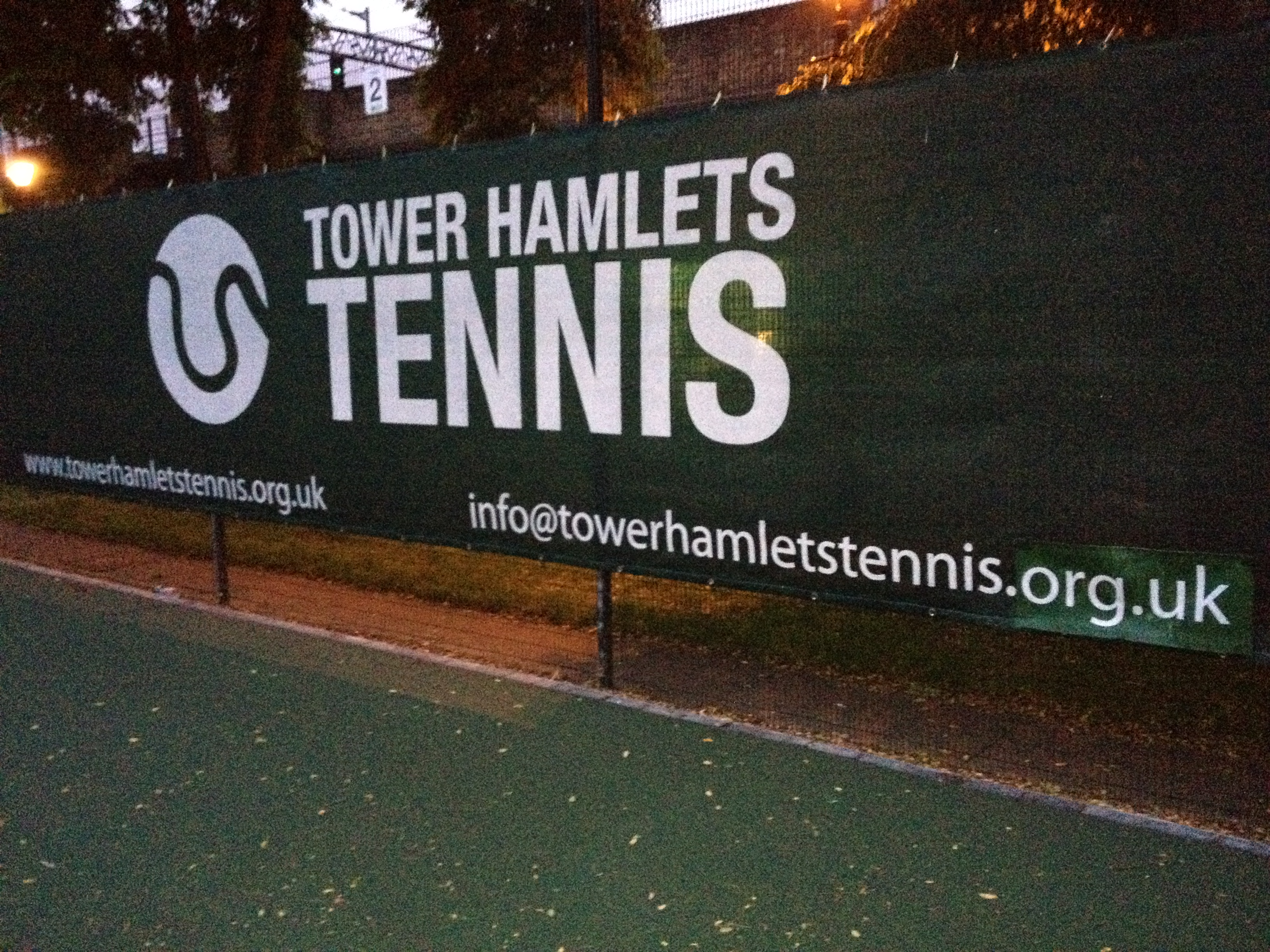 Printed tennis windbreak on our Austronet material for Tower Hamlets tennis club