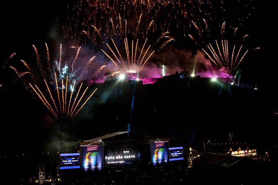 Fireworks at Hogmanay 2017 with Sunbaba's stage branding in the forefront