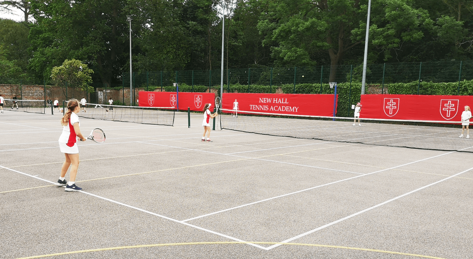 New Hall Academy tennis players on the newly branded courts